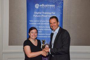 Holly Robinson winning digital marketing award from Matt Raad